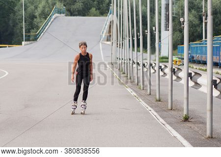 Active Seniors Woman Roller-skating Front View At The Stadion