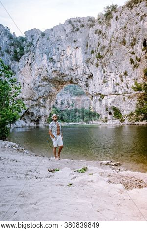 Guy On Vacation In The Ardeche France Pont D Arc, Ardeche France, View Of Narural Arch In Vallon Pon