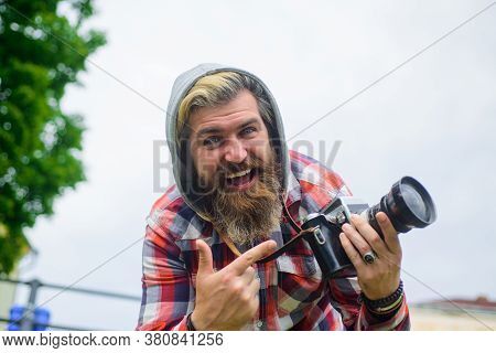 Bearded Man Taking Photographs. Man Photographs On Digital Camera. Handsome Man Traveler Make Photos