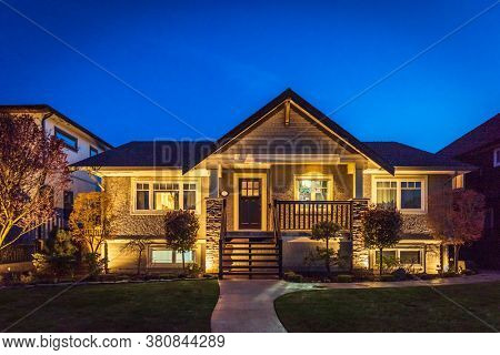 Luxury house at night with fantastic glow lights in Vancouver, Canada.