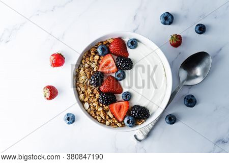 Fresh Breakfast With Greek Yogurt Nuts Oatmeal Granola With Berries In A Bowl
