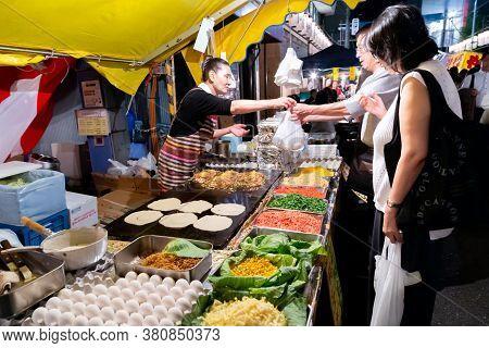 Tokyo, Japan - September 13, 2020 : Senior Japanese People Are Buying Japanese Fried Noodle (yakisob
