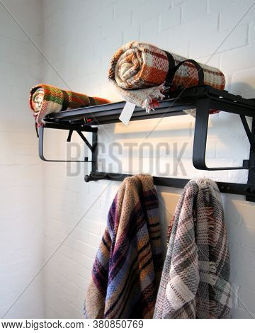Traditional Multi Colored Woolen Blankets In Different Colours, On A Vintage Metal Rack