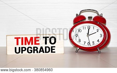 Alarm Clock And Text Time To Update. Time To Update Concept. Time To Update Concept Clock Closeup On