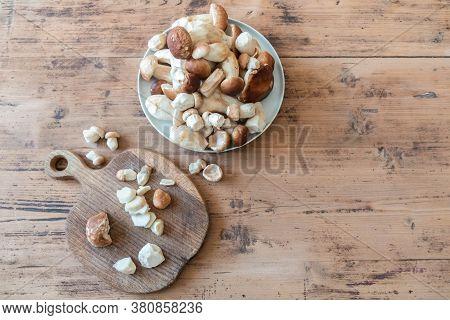 Edible Mushrooms On Rustic Table. Fresh Mushrooms Boletus Edulis In Plate And On Wood Board On Woode