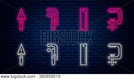 Set Line Clamp Tool, Ruler, Trowel And Clamp And Screw Tool. Glowing Neon Icon On Brick Wall. Vector