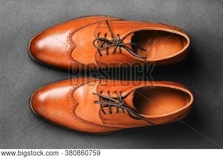 Pair Of Brown Shoes On A Black Background. Mens Fashion Shoes. Classic Mens Shoes Made Of Genuine Le