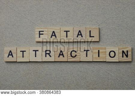 Phrase Fatal Attraction Made From Gray Wooden Letters Lies On A Background