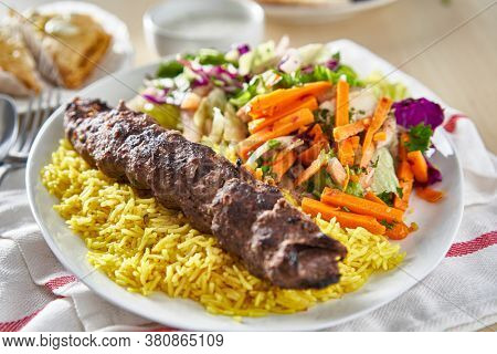 greek beef souvlaki platter with rice and pickled vegetables