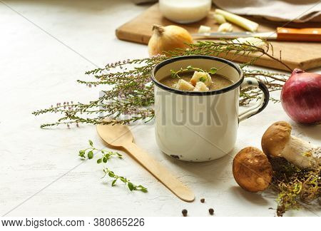 Cream Of Wild Mushroom Soup With Croutons In A Vintage Cup. On A Light Background With Space, Horizo