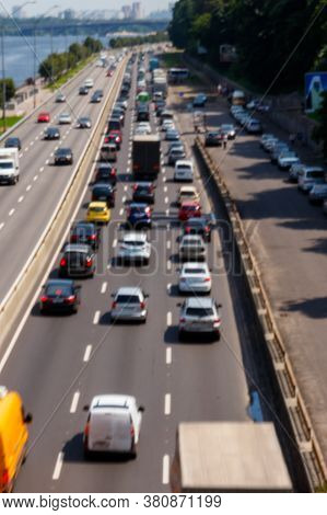 Blurred Abstract Background Of Traffic Cars On The Multi Lane Highway During Rush Hour