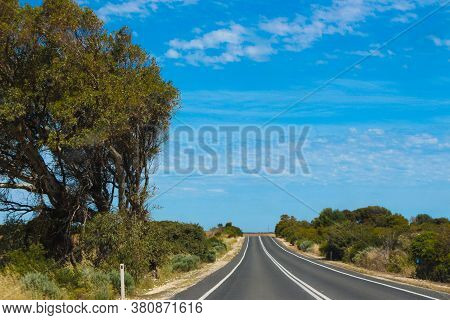 Long Stretch Of Road In The Australian Outback During A Summer Road Trip