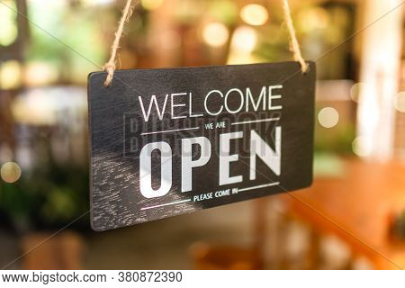 A Business Sign That Says Open On Cafe Or Restaurant Hang On Door At Entrance.