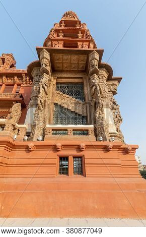 Low Angle Of The Tower Of Baron Empain Palace, A Historic Mansion Inspired By The Cambodian Hindu Te