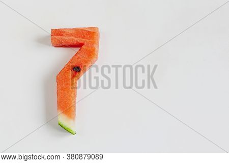 Number 7, The Digit Seven Carved From A Fresh Watermelon On A White Background.