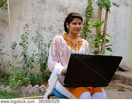 District Katni, India - May 16, 2020: An Indian Corporate Girl Looking At Camera During Laptop Worki