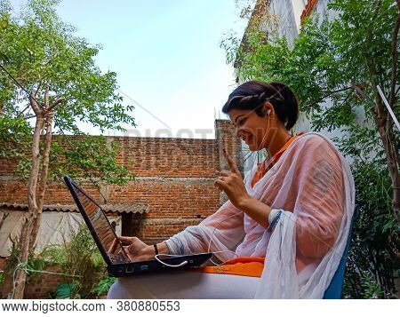 District Katni, India - May 16, 2020: An Indian Corporate Girl Working On Laptop, Work From Home At
