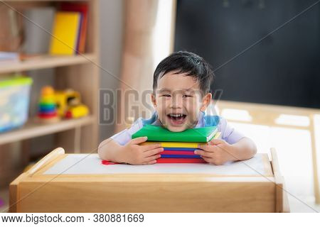 Asian Student Happy After Back To School And Smile In His Class Room In Preschool, This Image Can Us