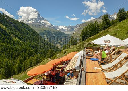 People Eating On A Restaurant Over Zermatt On The Swiss Alps