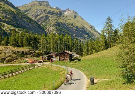 People Riding Bikes Over Zermatt On The Swiss Alps