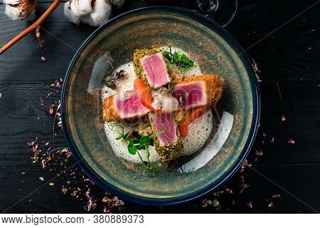 Lightly Seared Tuna Steak With Almonds. Close Up Lightly Fried Tuna Top View, Flat Lay