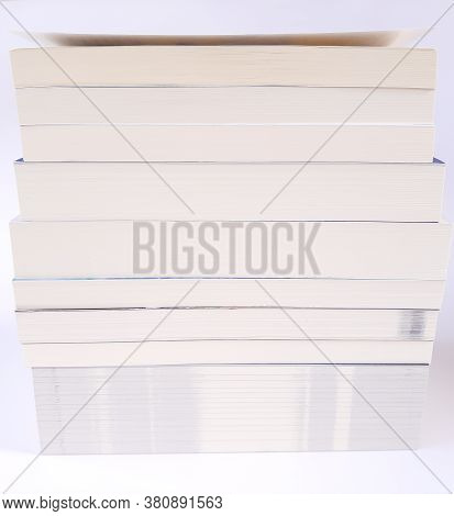 Stack Of Paperback Book On White Background
