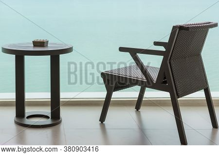 Table And Chair With Outdoor Balcony And Sea .the Chair And Table On Balcony Sea View. Chair With Ta