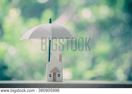 Umbrella For Protect To Home. Loan Or Saving Money For Property Protection Real Estate Concept.