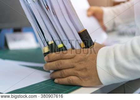 Businessman Working Stacks Unfinished Documents Achieves, Paperwork Files For Searching Information