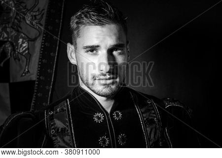 Portrait Of Handsome King With Beard Dressed In Costume Looking At Camera
