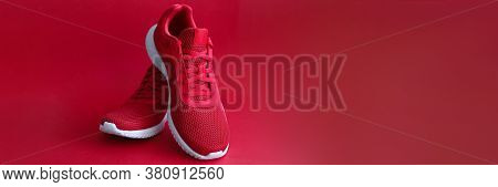 Close-up Of Red Sneakers On Bright Backdrop. Sport Footwear For Running And Fitness. Amazing Pair Of