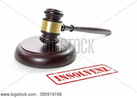 Judge Gavel And A Red Stamp With The German Word Insolvenz (meaning Insolvency) Isolated On A White