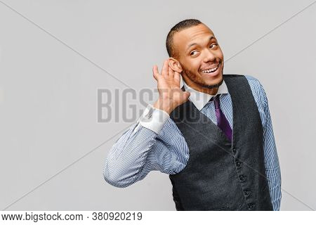 Young Handsome African American Businessman Listening Something Or Eavesdropping, Cant Hear You Conc