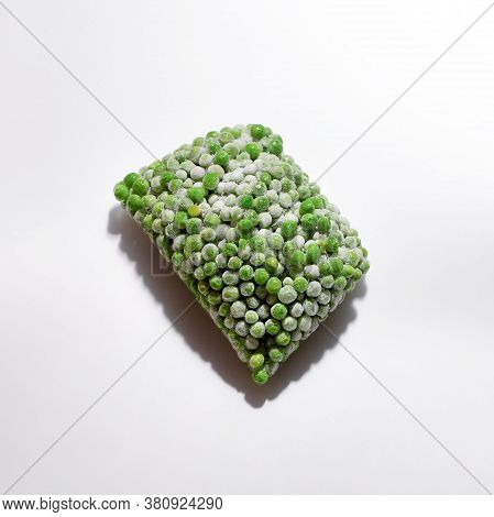 Frozen Food Vegetable Green Pea On White Background. Healthy Eating Concept