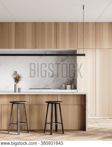 Interior Of Stylish Kitchen With Wooden And White Marble Walls, Wooden Floor And Bar With Stools. 3d