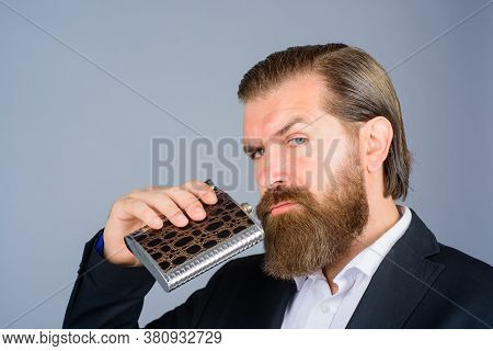 Gentleman In Elegant Suit Holds Flask With Alcohol. Bearded Hipster Wear Elegant Suit Hold Metal Fla