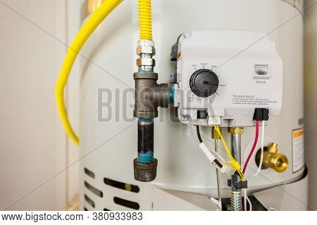 Close Up Shot Of A Modern Hot Water Heater Control Thermostat. Great Image Concept For Plumbing, Wat