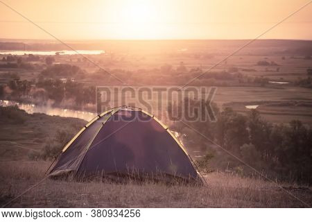 Tourist Tent At Riverbank Sommer Sunrise. Active Lifestyle And Healthy Concept