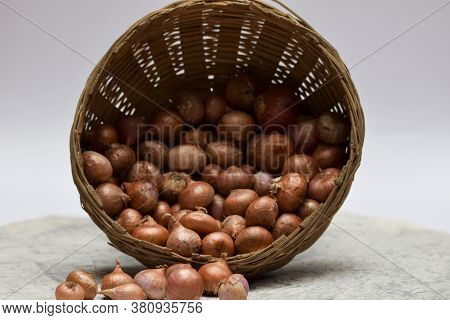Close Up View Of Small Onions. Indian Vegetables Heap Small Shallot Onions From Market