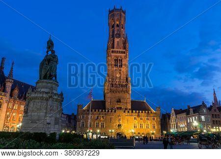.bruges, Belgium - 14 November 2019: Old Buildings In Central Market By Night In Bruges, Belgium