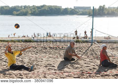 Moscow, Russia - July 14, 2020: Sit Disabled Amputee Volleyball Players Play At Beach.