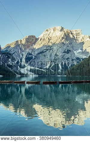 View Of Braies Lake With Boats In Dolomites Mountains And Seekofel In The Morning, Sudtirol, Italy