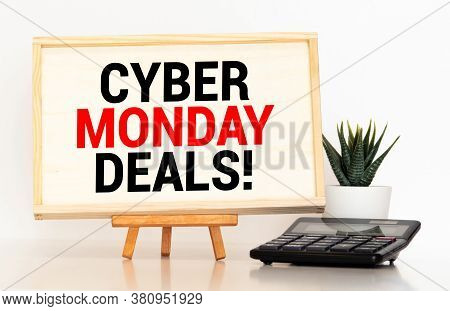 Cyber Monday Message With Workstation On A Light Green Wooden Desk.