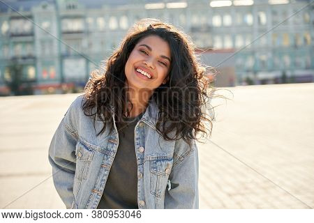 Happy African Young Woman Wearing Denim Jacket Laughing Looking At Camera Standing On Street. Smilin