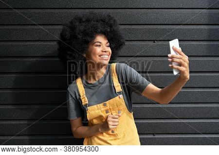Happy African American Hipster Teen Girl Blogger With Afro Hair Laughing, Holding Phone, Recording V