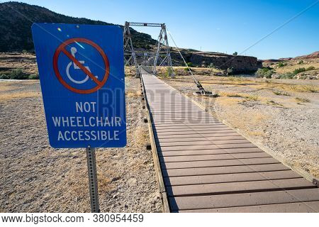 Not Wheelchair Accessible Sign On The Boardwalk Trail Area Leading To The Swinging Bridge In Hot Spr