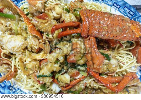 Freshly Cooked Lobster Pieces In Ginger And Shallot (scallion) Sauce, With Fried Noodles As Base; Ho