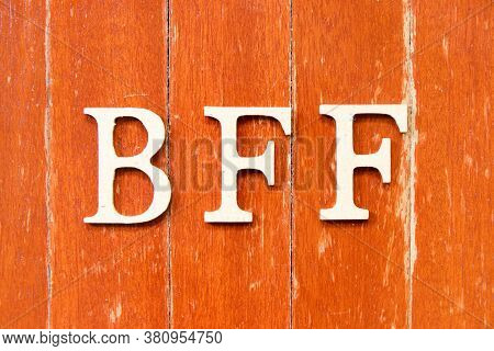 Alphabet Letter In Word  Bff (abbreviation Of Best Friend Forever) On Old Red Color Wood Plate Backg