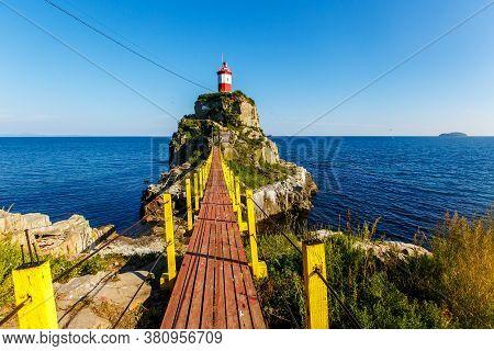 The Most Beautiful Lighthouse In Vladivostok Is The Basargin Lighthouse. Marine Lighthouse In Vladiv