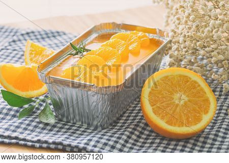 Fresh Baked Sweet And Delicious Mandarin Orange Sponge Cake Decoration With Orange Jelly Sauce And O